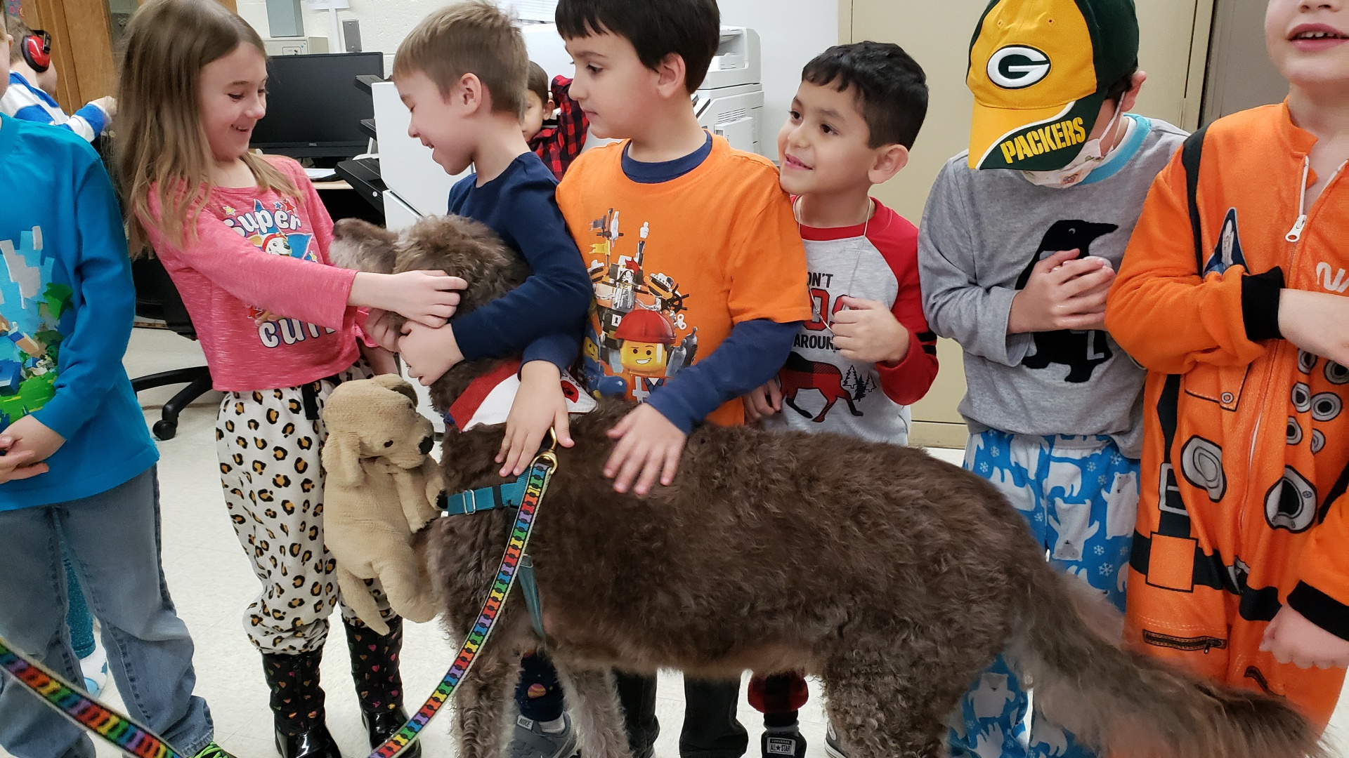 Students welcome Cocoa, a therapy dog.
